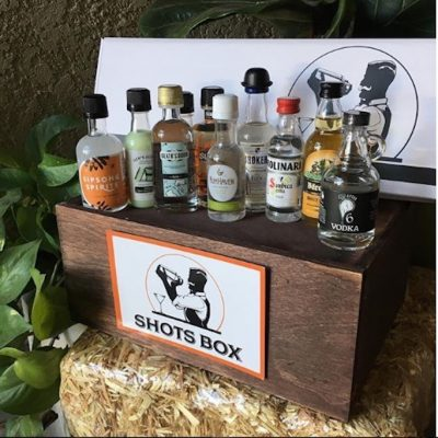 A sample Shots Box with the mini bottles lined up in front of the open box